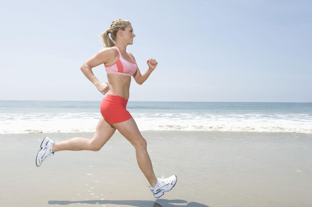 woman running along a beach