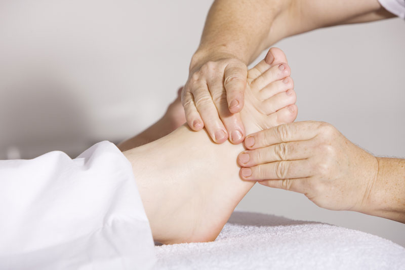 podiatrist treating patient with foot pain